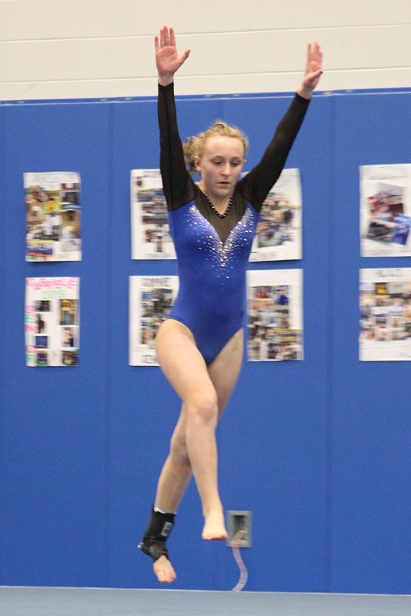 Nicole+Wasyliw+%2810%29+gets+ready+to+perform+a+pass+on+floor.+The+girls+celebrated+senior+night+at+their+meet.