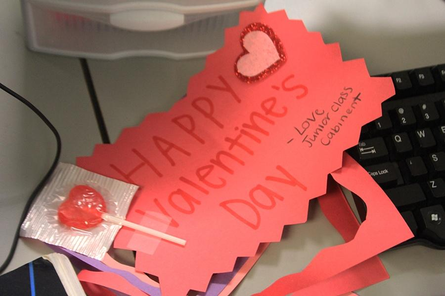 Valentine's Day cards await to be passed out. Cabinet members tapped stickers to the cards.