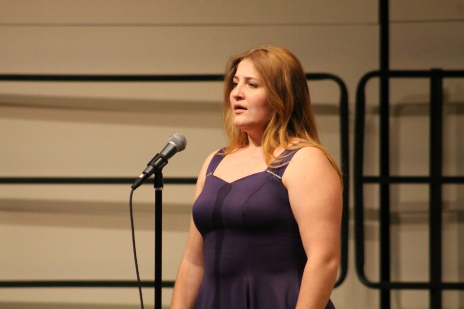 "Emily Mosher (12) performs her vocal solo of ""Deep RIver"" by Harry T. Burleigh. The choir's classics concert featured six different solos by different students."