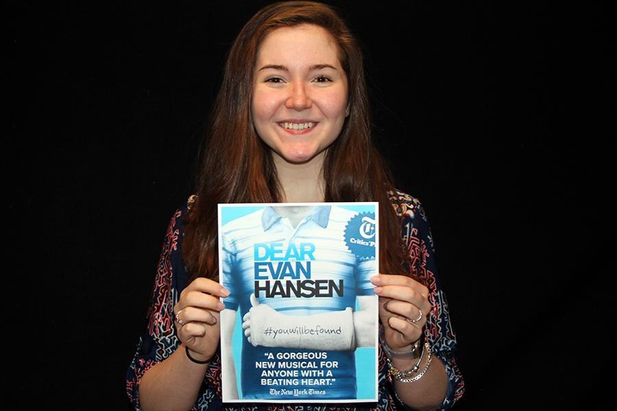 Tenley Edvardsen (10) holds up the Broadway show poster of 'Dear Evan Hansen.'