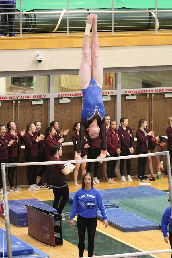 Madeline+Bugg+%2810%29+does+a+giant+on+the+bars+just+before+she+dismounts.+Her+score+was+an+outstanding+9.425.