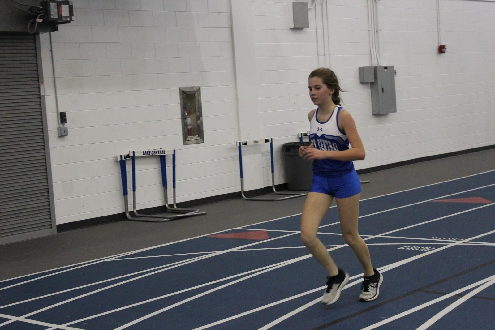 Taylor+Kosiek+%289%29+runs+during+the+one+mile+event+against+Morton+High+School+and+Highland+High+School.+Kosiek+competed+in+both+the+one+mile+and+two+mile+event+in+the+meet+on+Friday%2C+March+8.