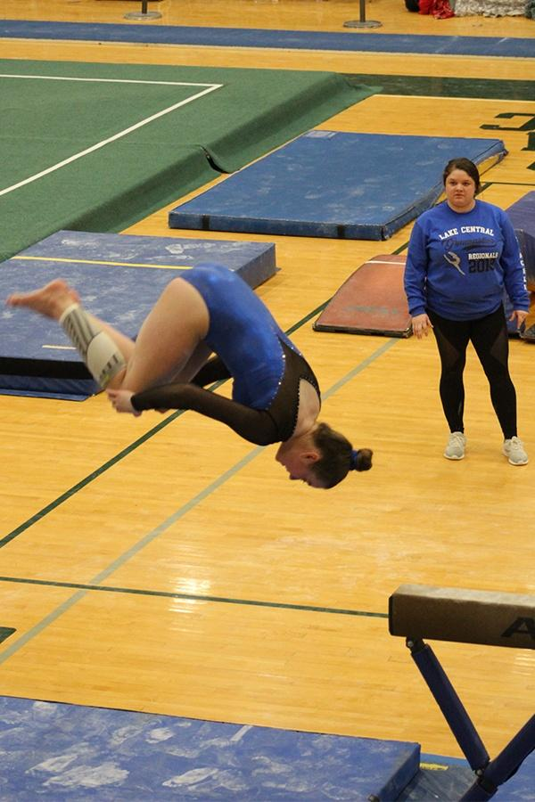 Allison+Mybeck+%2810%29+tucks+off+the+beam+to+finish+her+routine.++Her+performance+left+her+with+a+9.125+overall.++