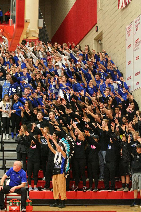 +A+big+crowd+of+students+support+the+boys+at+the+first+game+of+Sectionals.+Each+grade+level+had+to+wear+a+different+color+to+represent+Lake+Central.