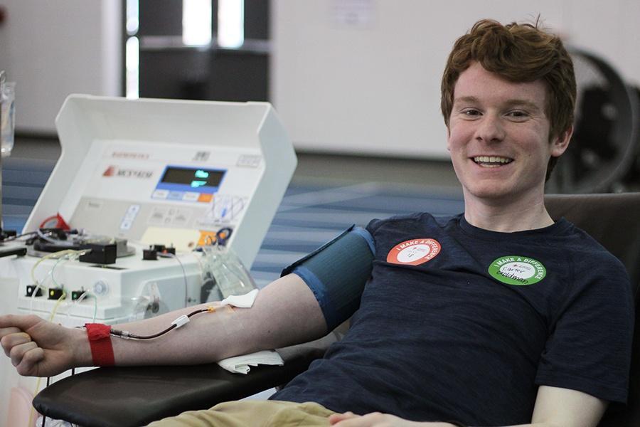 Carter Goldman (12) smiles as he donates blood. Goldman donated O-negative blood.