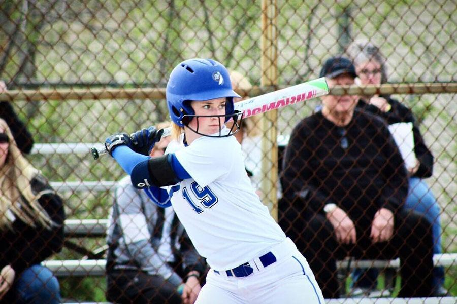 Cayla+Costello+%289%29+stares+down+the+ball+at+home+plate.+She+made+it+to+first+base.+