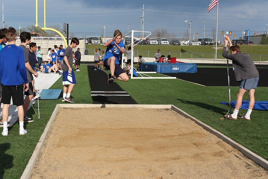 Trent+Schneider+%2811%29+competes+in+the+long+jump.+His+distance+was+measured+at+13+feet+and+8+inches.