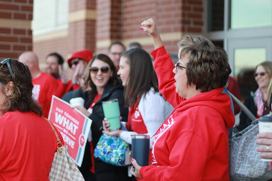 Mrs. Susan Schwitzer, Education Technology Trainer chants 'Red for Ed!' after Mrs. Shupryt's speech. The staff came together to support increased public education funding.