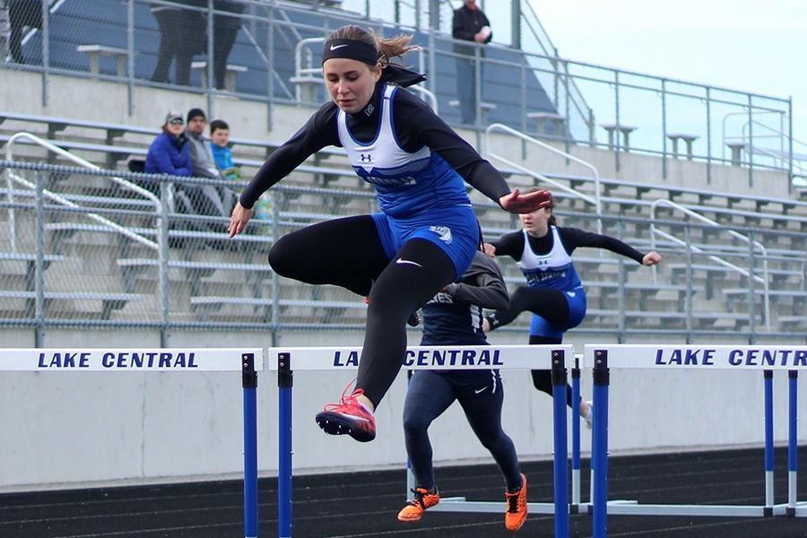 Cara Eklund (10) leaps over the last hurdle in her event. The next girls varsity track meet will be held at home on April 30, 2019.