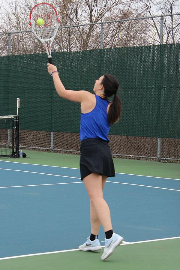 Hanna+Mihalic+%2812%29+practices+her+serves+during+warm+ups.+Mihalic+competed+in+a+singles+matches.++