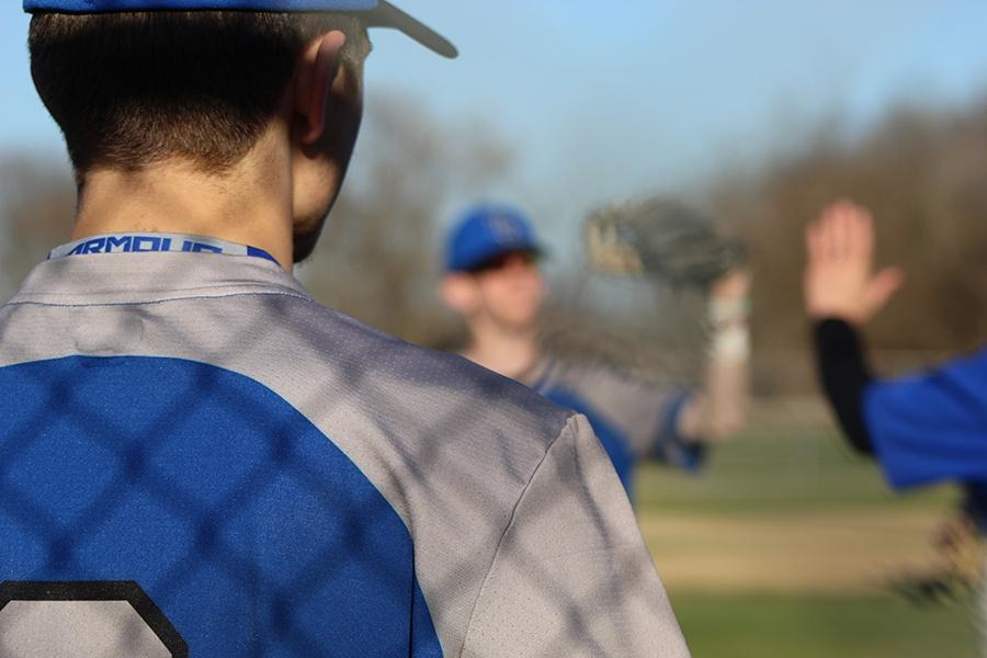 Sam+Richter+%2810%29+congratulates+his+teammates+on+a+job+well+done+after+a+successful+half+inning+in+the+field.+The+Indiana+will+face+Merrillville+on+the+16th+at+Merrillville.+