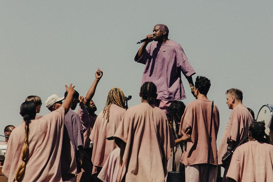 """Kanye West performs """"Ultralight Beam"""" along with the gospel choir. The performance was said to be very emotional and merciful. Image Source: New York Times"""