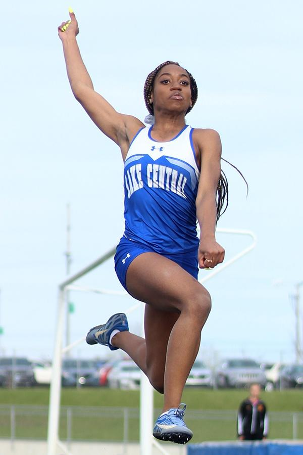 LaTreasure+Johnson+%2810%29+flies+through+the+air+during+her+event-+the+long+jump.+Johnson+broke+the+school+record+by+3.75+inches.
