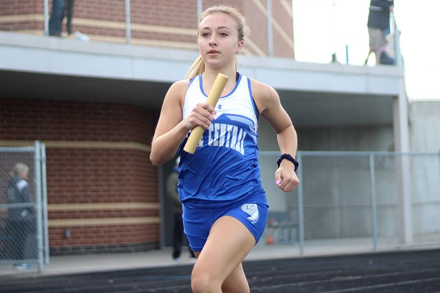 +Looking+ahead%2C+Krista+Kulacz+%289%29+runs+her+relay+race.+The+track+team+beat+both+Chesterton+and+Michigan+City+High+School+at+their+meet.