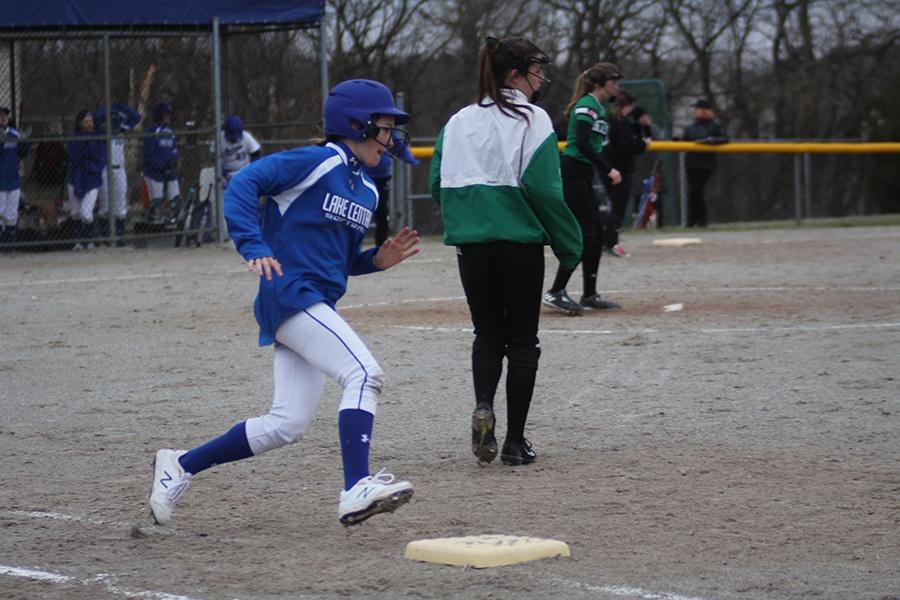 Kiley+Connor+%289%29+runs+around+the+bases+after+being+at+bat.+Connor+scored+a+point+on+this+play+after+hitting+a+homerun.+