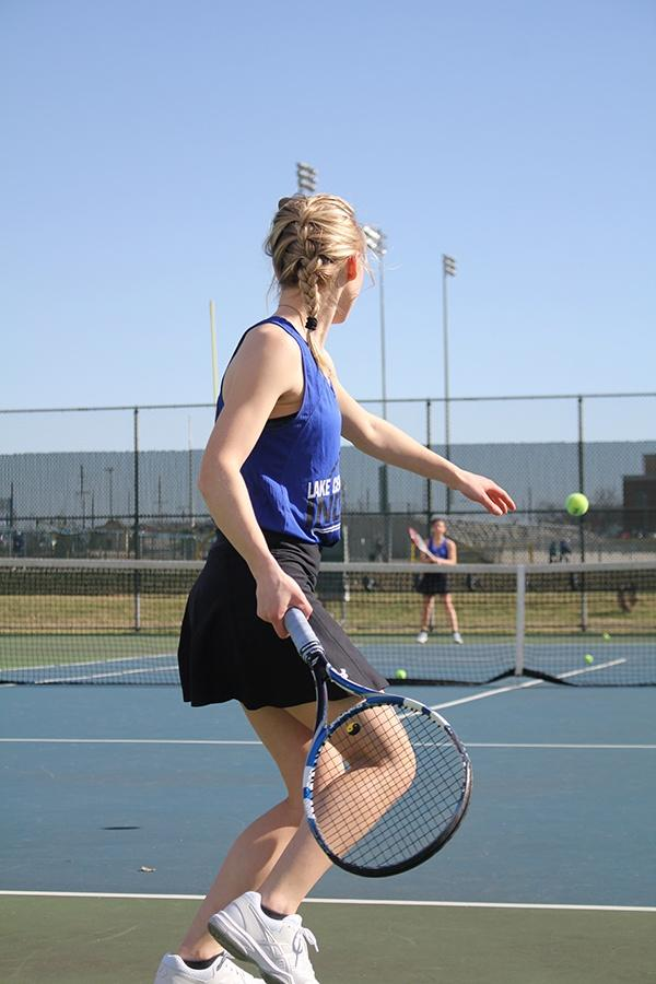 Jenny+Tulsiak+%2810%29+practices+her+forehand.+She+played+in+singles+during+this+game.
