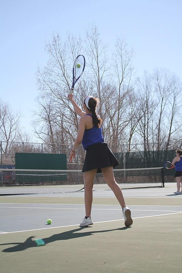 Sarah+Cunningham+%2810%29+works+on+perfecting+her+serves+before+the+match.+Cunningham+has+only+been+in+tennis+for+one+year.