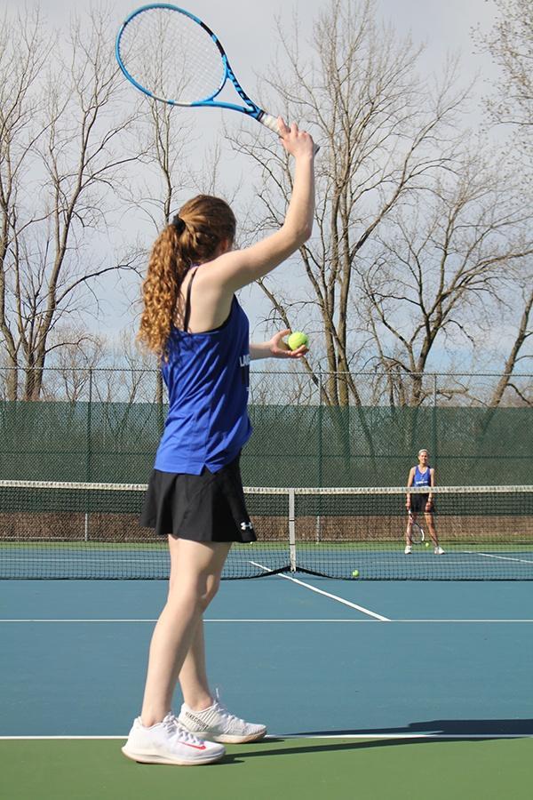 Elizabeth+Sulek+%2810%29+practices+her+serves+over+the+net.+Elizabeth+has+just+recently+taken+up+tennis.