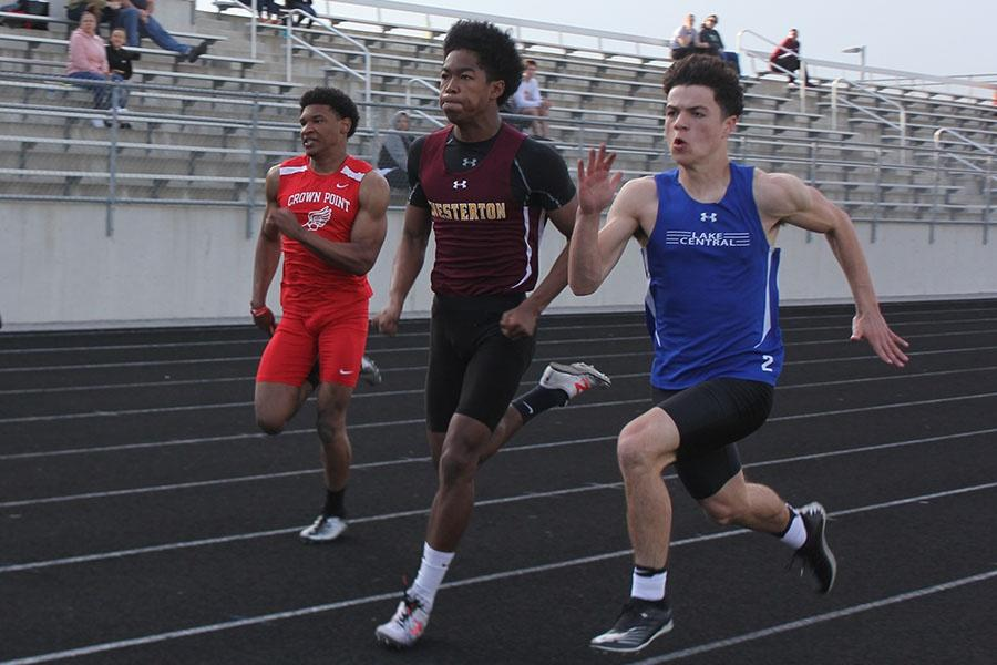 Jackson Sarbieski (11) sprints in attempt to beat the other runners. Sarbieski competed in the 100m dash.