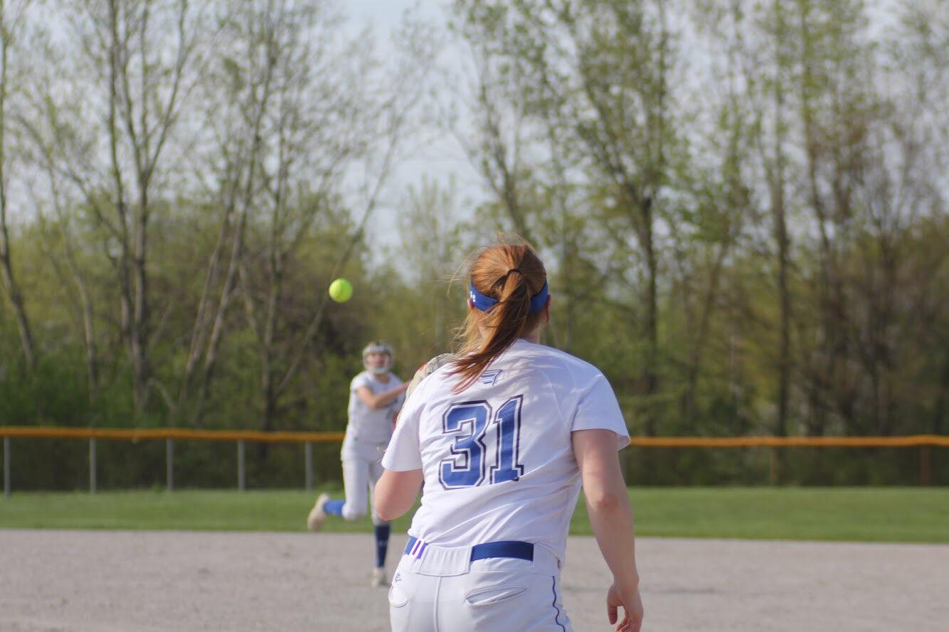 Gabby+Fredrickson+awaits+an+incoming+throw+as+she+attempts+to+make+an+out+at+first+base.This+is+the+second+time+the+girls+faced+off+against+laporte+this+season.