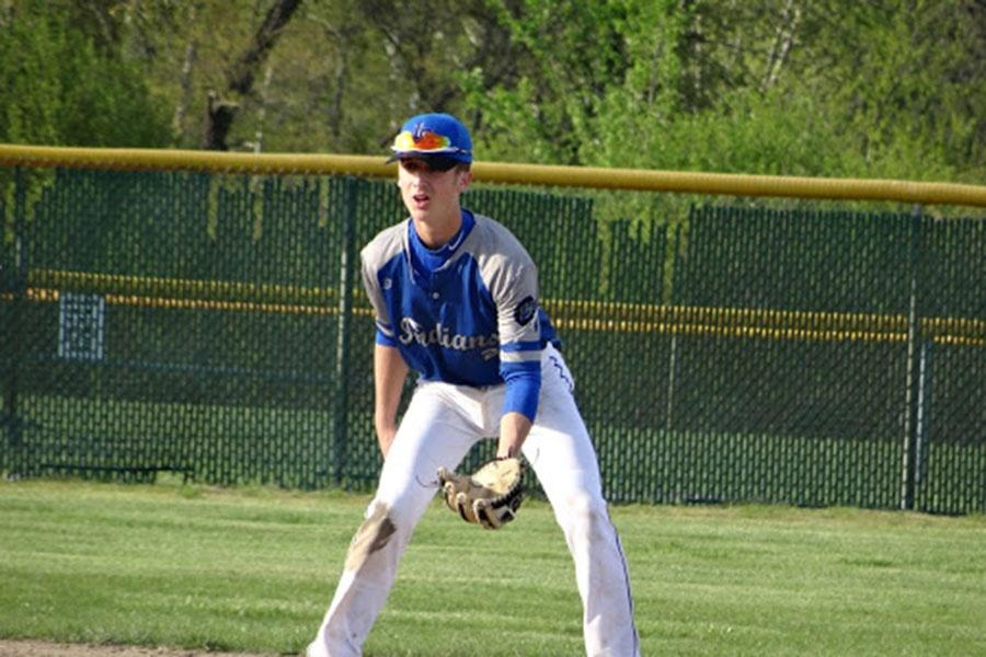 Aiden+Kluth+%289%29+prepares+to+catch+a+fly+ball.+He+caught+many+balls+that+were+hit+by+the+opponents.