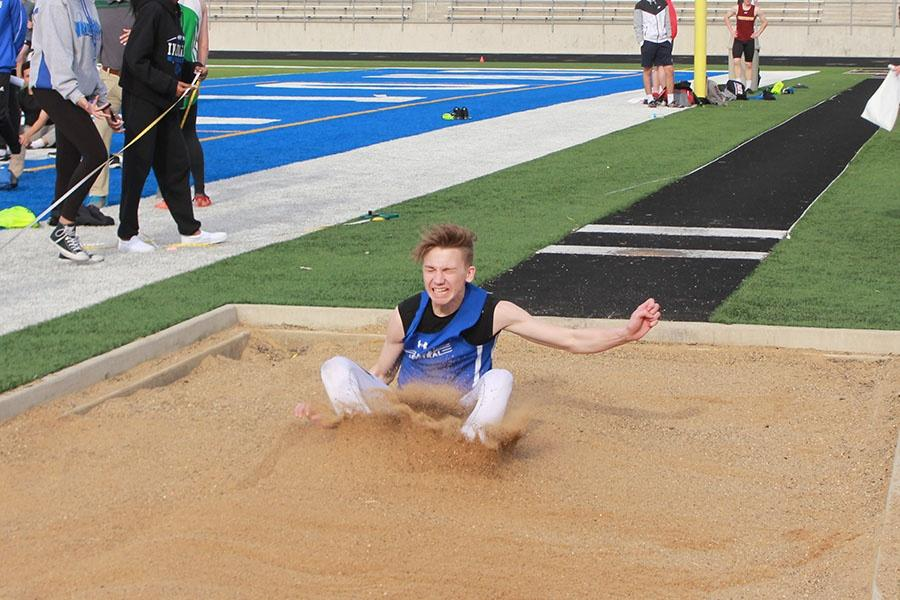 Brandon+McPherson+%2811%29+lands+after+competing+in+the+long+jump+event.++McPherson+got+a+distance+of+18%E2%80%99+5%E2%80%9D.+