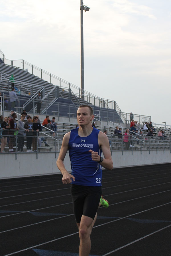 +Logan+Russell+%2810%29+running+past+the+finish+line.++Russell+ran+two+PR%E2%80%99s+in+the+mile+and+two-mile+races.