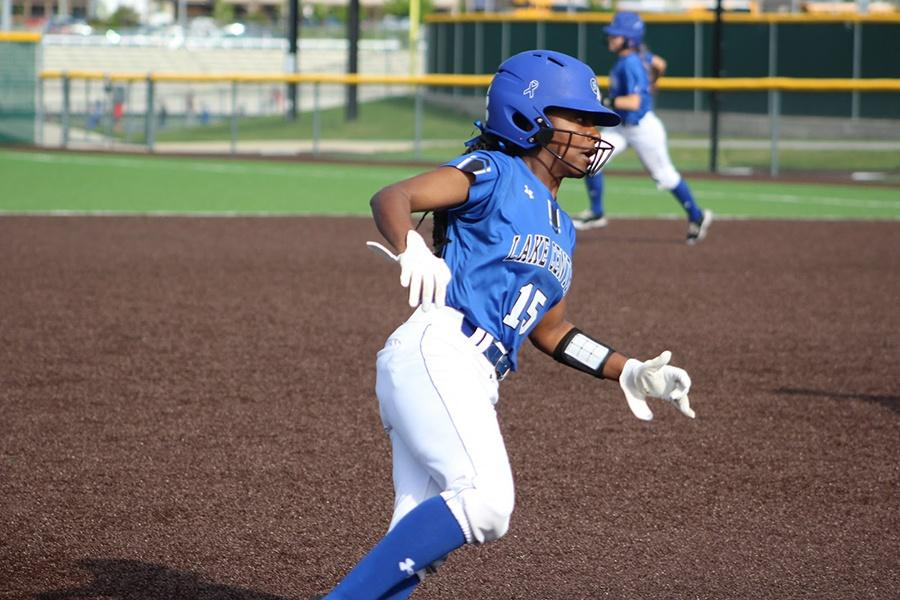 Alexis+Johnson+%2811%29+rounds+third+base+and+heads+for+home+plate.+The+varsity+softball+team+has+had+a+great+season+so+far%2C+with+few+losses.+