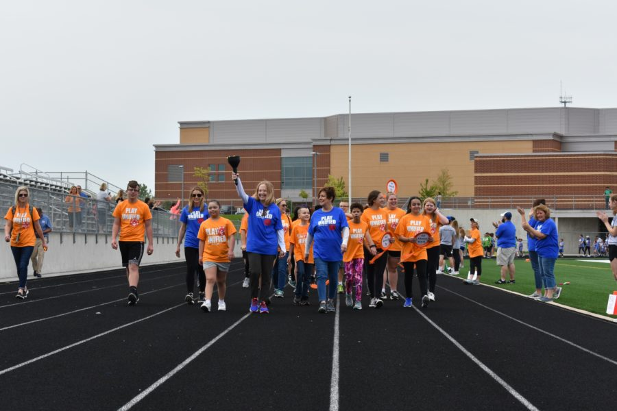 Kahler+Middle+School+leads+the+way+in+the+first+lap+around+the+track+to+kick+things+off.+Some+events+that+the+students+could+participate+in+included+hurdles%2C+running+down+the+track%2C+an+obstacle+course+and+a+jumping+contest.+