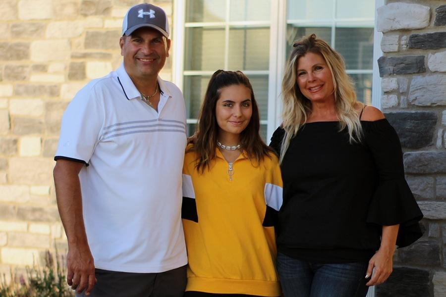 Claudia Alonso (11) poses with her host family. Alonso came to America one week before school started.