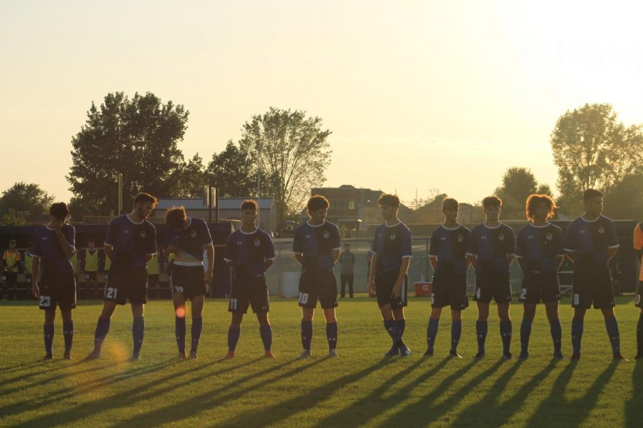 The boys line up for the pledge before the start of the game. The JV and Varsity boys took on Munster on Sep. 2, 2019.