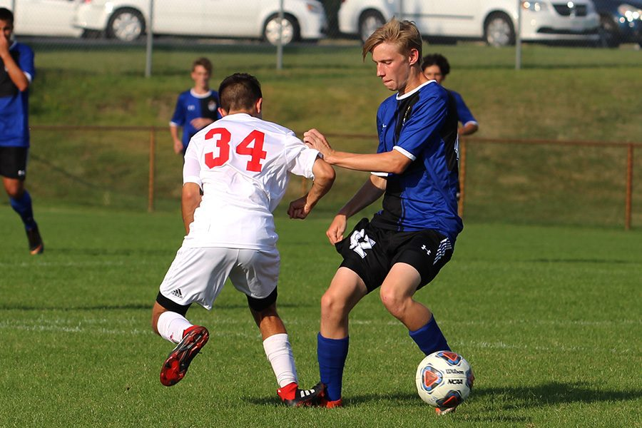 Matthew Szabo (10) battles with Munster player to gain control of the ball. Szabo had several shots during the game.