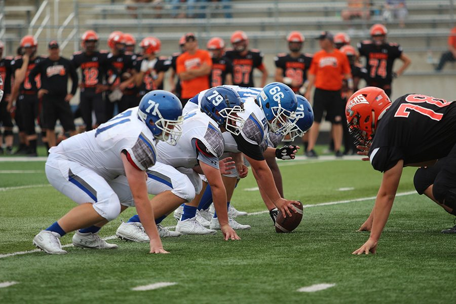 Christian Jones (11) waits to snap the ball to gain yards for the play. The offensive line  is one of the most important elements of the team, guarding the quarterback from getting sacked.