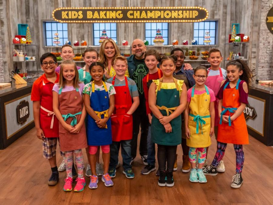 The+nine+young+contestants+smile+for+a+picture+with+the+hosts+Duff+Goldman+and+Valerie+Bertinelli.+They+were+eager+to+show+Goldman+and+Bertinelli+what+they+were+capable+of+in+the+kitchen.++