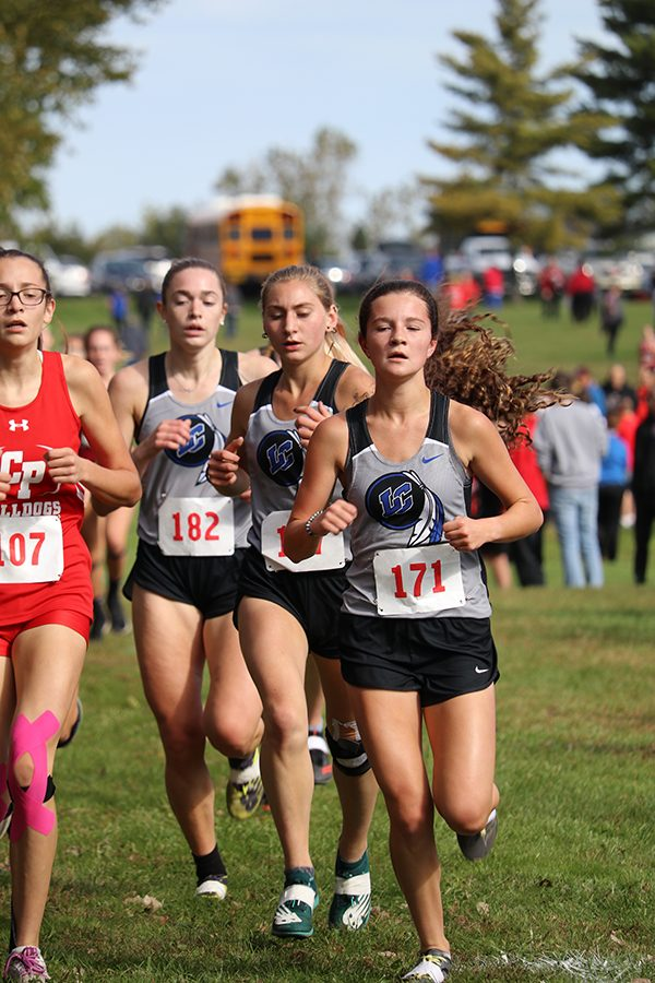 Carly Davis (10), Abby Martisek (11) and Lillian Zubeck (12) form a pack to stick together during the race. Davis came in 11th place, Zubeck in 14th place and Martisek in 19th place.