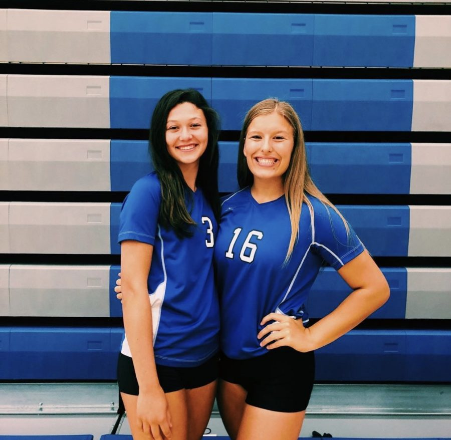 Katharine Mahoney (11) poses with Maddy Bailey (12) at the beginning of the season.  Mahoney said that her team this year has been extremely close with one another.