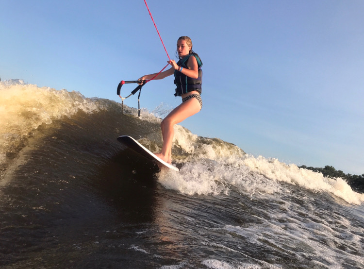 Madelyn Sternfeldt wake surfs on Lake Shafer in Monticello, Indiana. Her family owns a lake house near there.