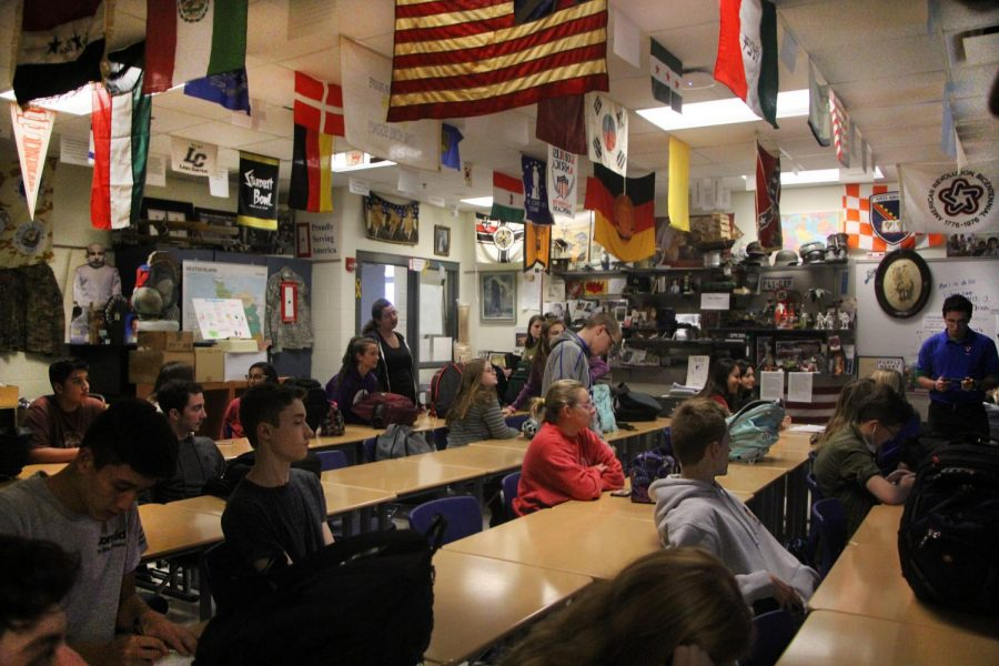 All club members gather in the classroom at the end of the day on Fridays for their meeting.  The students waited for Mr. Clark to begin the meeting.