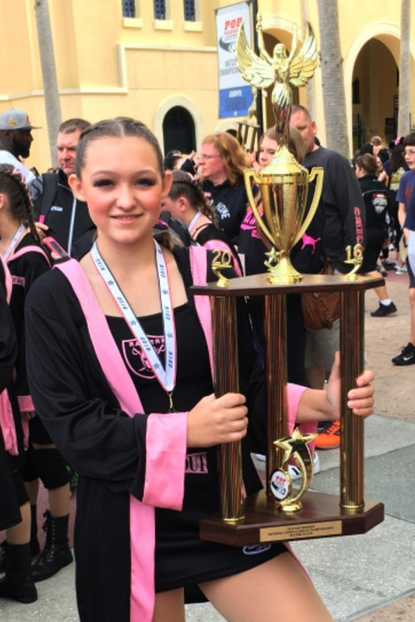 Lillian Gurtatowski (10) poses with her trophy at the national competition in Disney World. She competed with the Tri-Town Raiderettes dance team.  Photo submitted by: Lillian Gurtatowski (10)