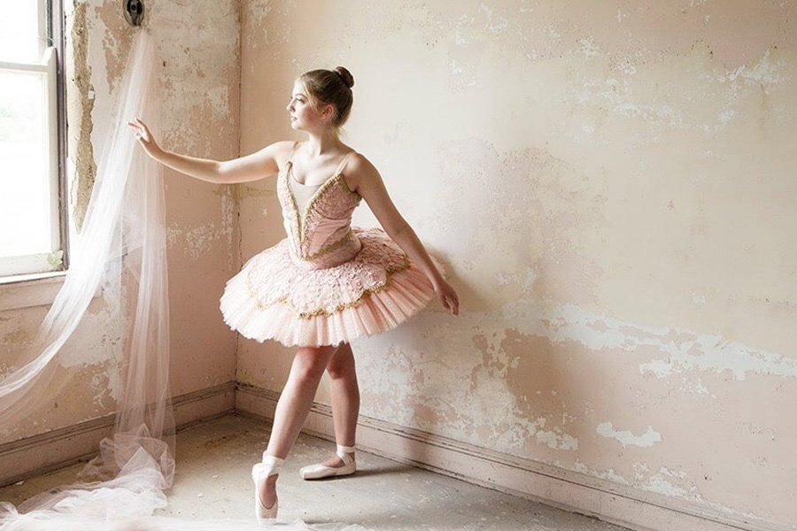 Audrey DiFilippo (11) poses in a ballet tutu from The Nutcracker and pointe shoes. She has dedicated so much time over the years to perfecting her skills. Photo submitted by: Audrey DiFilippo (11)