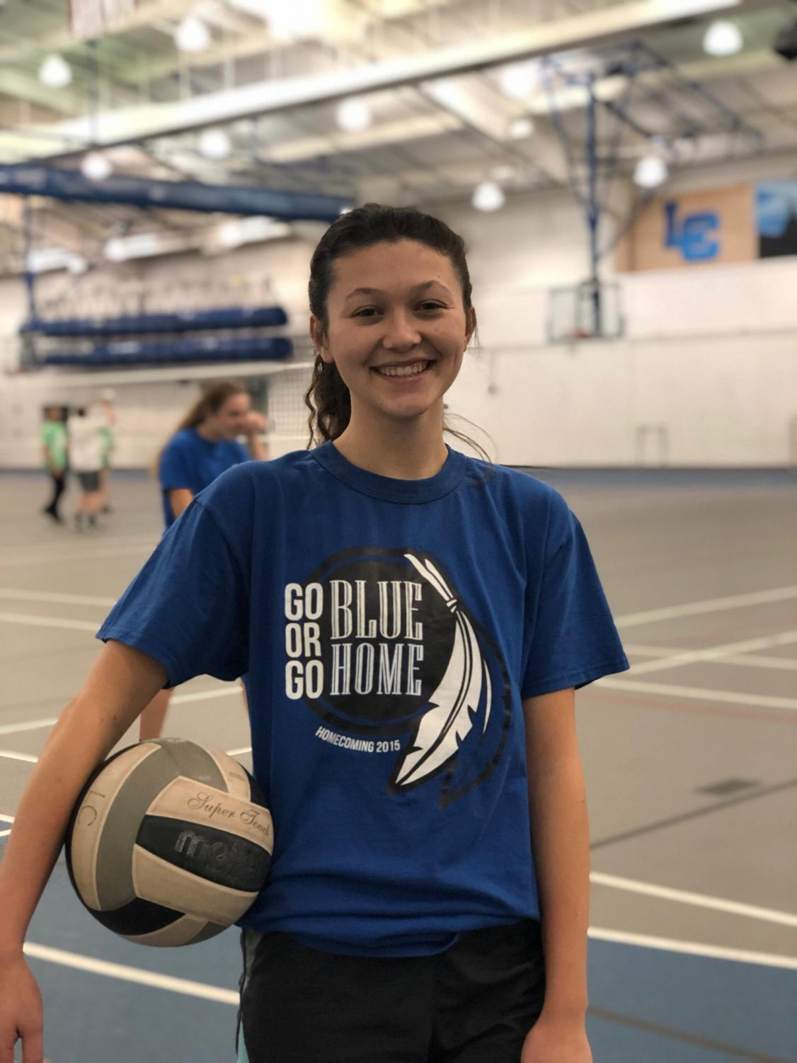 Katharine Mahoney (11) poses with a volleyball before her big game last Tuesday. After playing two games, her team won one and lost the other against their opponents.