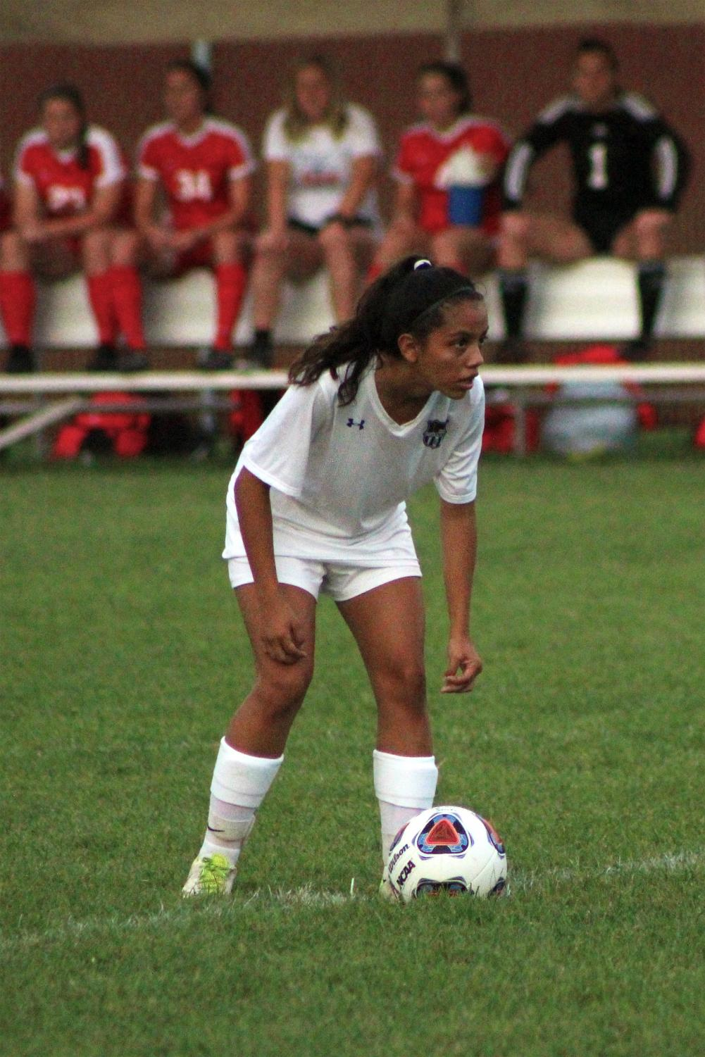 """Joanna Lomeli (10) observes her surroundings. Lomeli has played soccer for around 10 years and has worked hard to obtain a position on the Varsity team."""" Photo by Brian Scott (11)."""