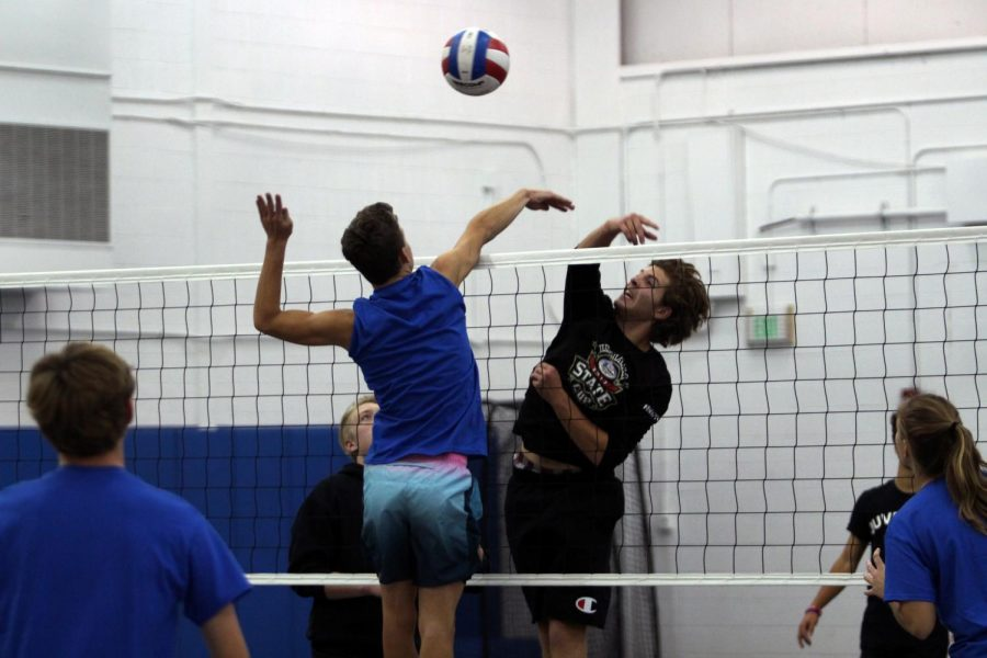 Daniel+McGrath+%2811%29+and+Robert+MacNeill+%2812%29+go+hand-in-hand+to+get+the+volleyball+over+to+the+opposing+team.+The+two+teams+had+a+competitive+match+against+one+another.