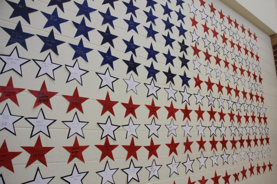 Students use creativity in decorating a wall in Main Street.  They used the remainders of the stars to create the American flag.