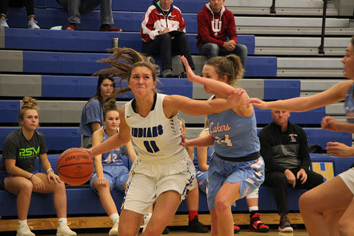 Jen Tomasic (11) dribbles the ball down the court during the second quarter, trying to get a shot while defending the ball from Lakeland.  She then scored another point, creating a larger lead for Lake Central.
