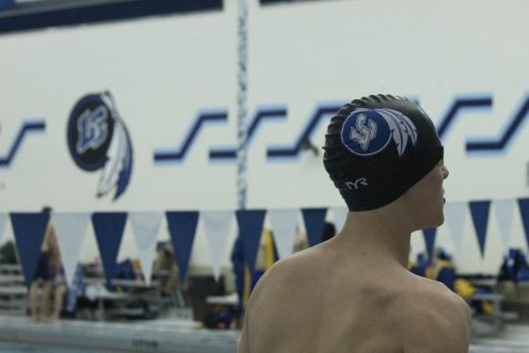 A Lake Central Varsity swimmer looks at the scoreboard to see how well he placed during his race. Lake Central won against Highland with an end score of 144-34.
