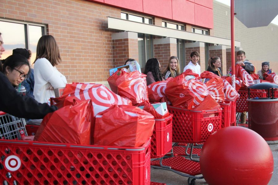 Student+council+and+NHS+members+line+up+their+carts+in+front+of+Target.+The+members+bought+toys+for+the+Angel+Tree+tags+that+were+not+completed.+