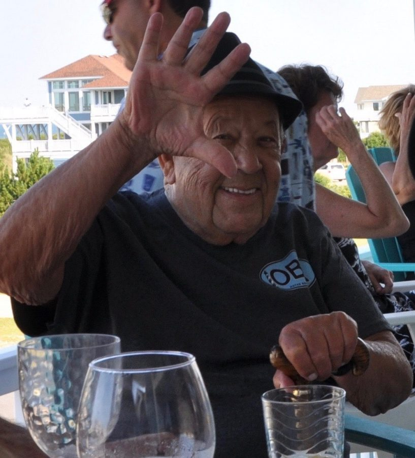 Bob Wojciechowski (88) waves at the camera on a family vacation to South Carolina. Wojciechowski is 100% Polish and shares his traditions among his family members.
