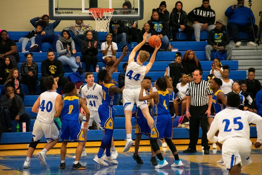 Nate Oakley (11) jumps in order to make a basket. The boys won the game with a score of 58-34.