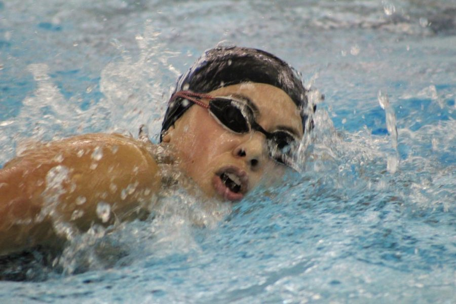 Natalia Mendoza (12) swims quickly across the pool during her event. Mendoza swam in the 500 meter free event.